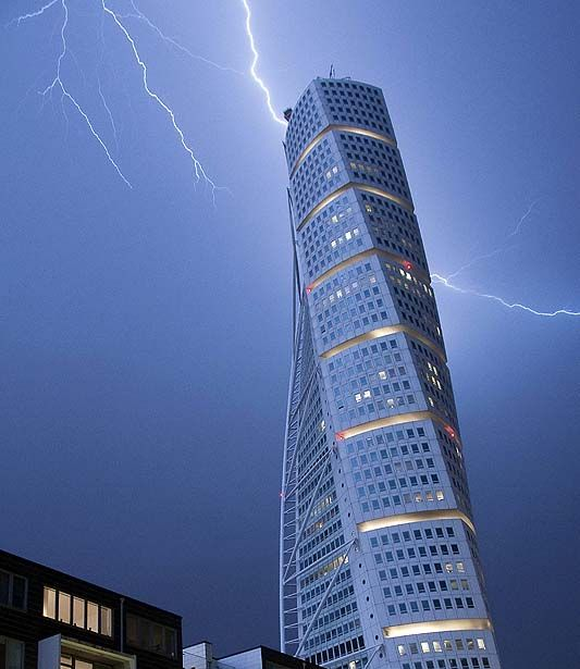 Lightning strikes the 190 m (623 ft)-high Turning Torso building in Malmo early morning on June 7, 2011. As the unseasonally hot weather was replaced by cooler winds, heavy rain and thunderstorms struck Sweden's South-west coast.  TOPSHOTS   AFP PHOTO / SCANPIX - JOHAN NILSSON (Photo credit should read JOHAN NILSSON/AFP/Getty Images)
