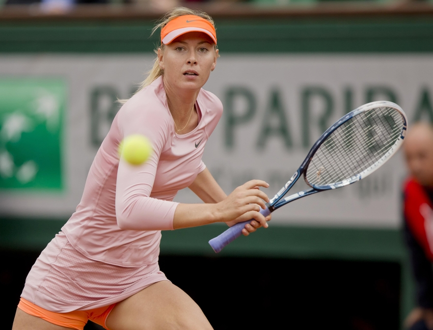 May 26, 2014; Paris, France; Maria Sharapova (RUS) in action during her match against Ksenia Pervak (RUS) on day two at the 2014 French Open at Roland Garros. Mandatory Credit: Susan Mullane-USA TODAY Sports