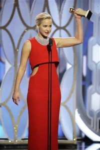 "In this image released by NBC, Jennifer Lawrence accepts the award for best actress in a motion picture comedy for her role in ""Joy""at the 73rd Annual Golden Globe Awards at the Beverly Hilton Hotel in Beverly Hills, Calif., on Sunday, Jan. 10, 2016. (Paul Drinkwater/NBC via AP)"