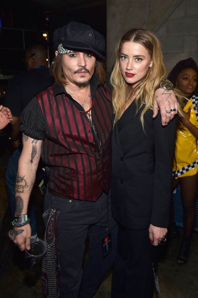 gallery-1459190274-johnny-depp-amber-heard-032816